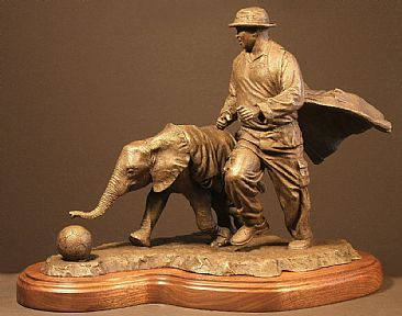 Football Buddies - Orphaned African elephant with keeper by Douglas Aja