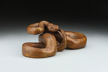 Space Invasion - Prairie Rattlesnake - Copper-colored patina by Eva Stanley